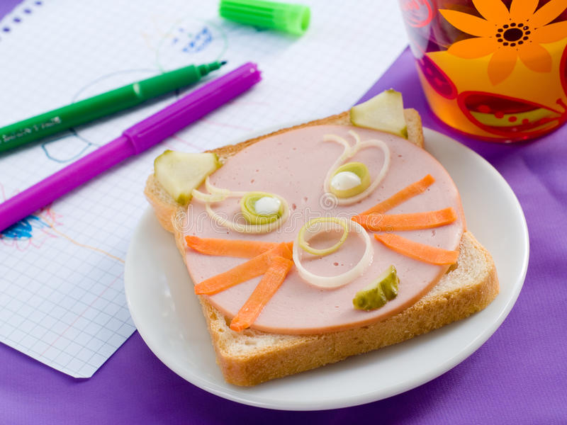 Breakfast. With sandwich for child with drink on background. Selective focus royalty free stock photo