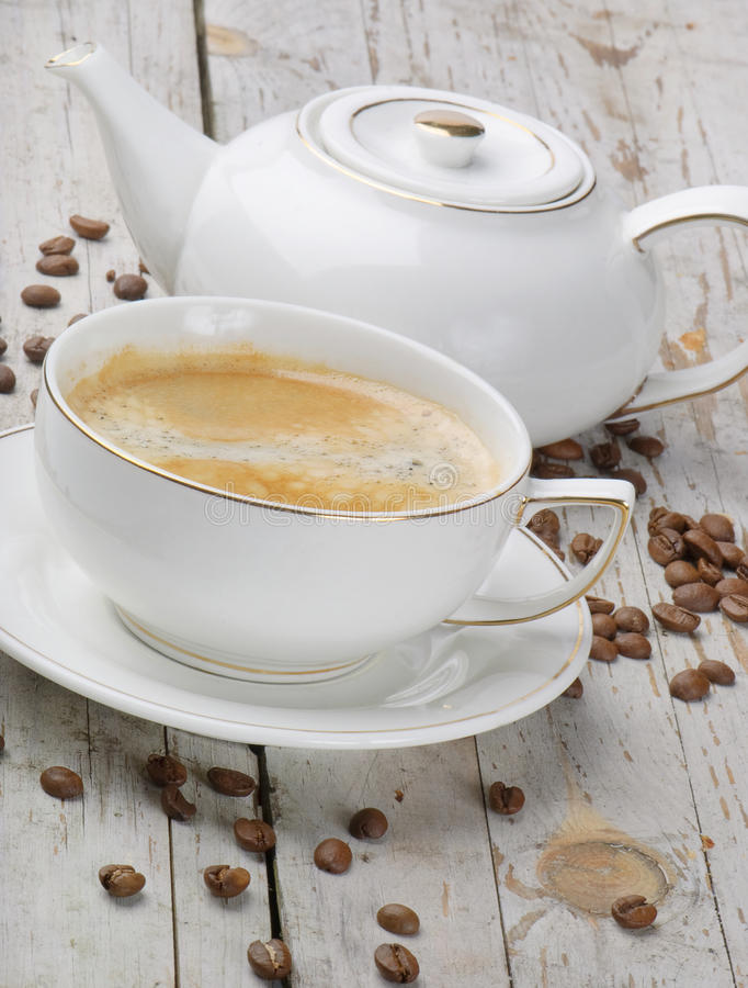 Breakfast. Coffee cup and beans royalty free stock photos