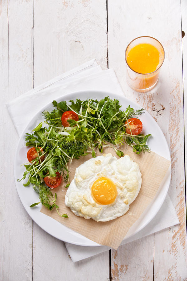 Breakfast. Baked egg with salad stock image