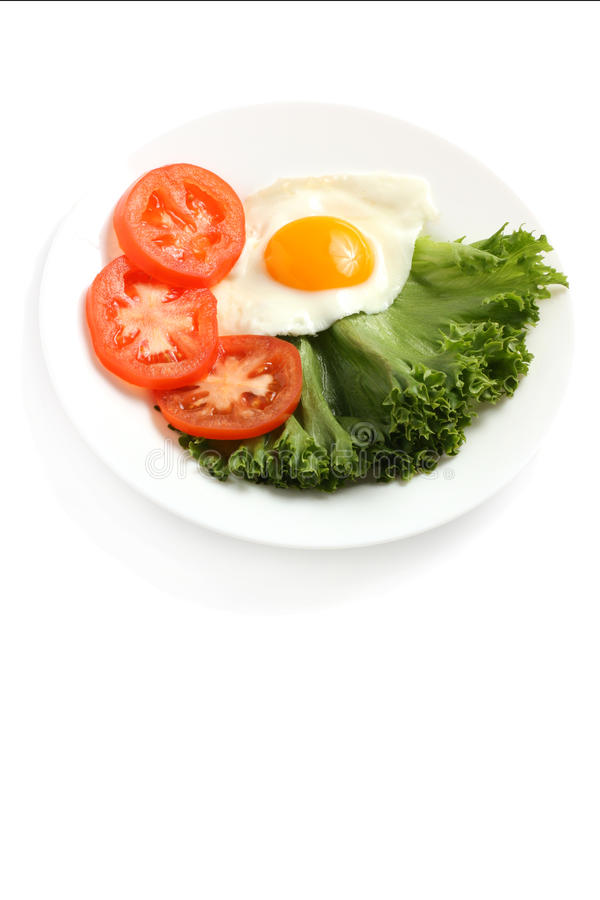 Breakfast. Consisting of eggs, tomatoes and lettuce stock images