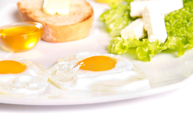 Breakfast. Sunny side eggs, honey and cheese breakfast royalty free stock photography