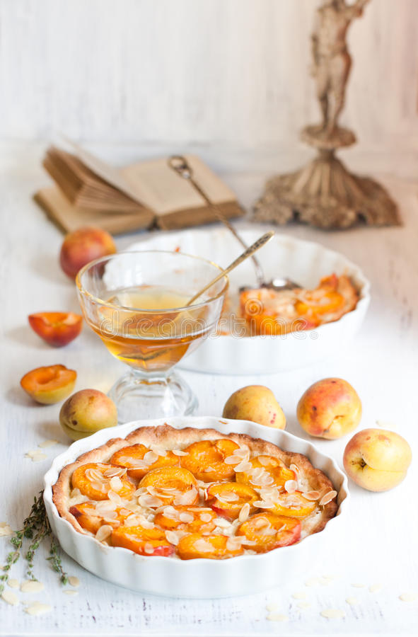 Breakfast with apricot tart stock images