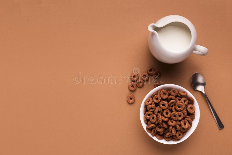 Breakfast background - milk, corn cereals, spoon top view stock photography