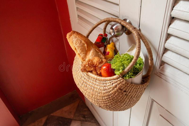 Freshly breakfast basket hang on door knob. Breakfast basket hanging on door knob in the morning stock image