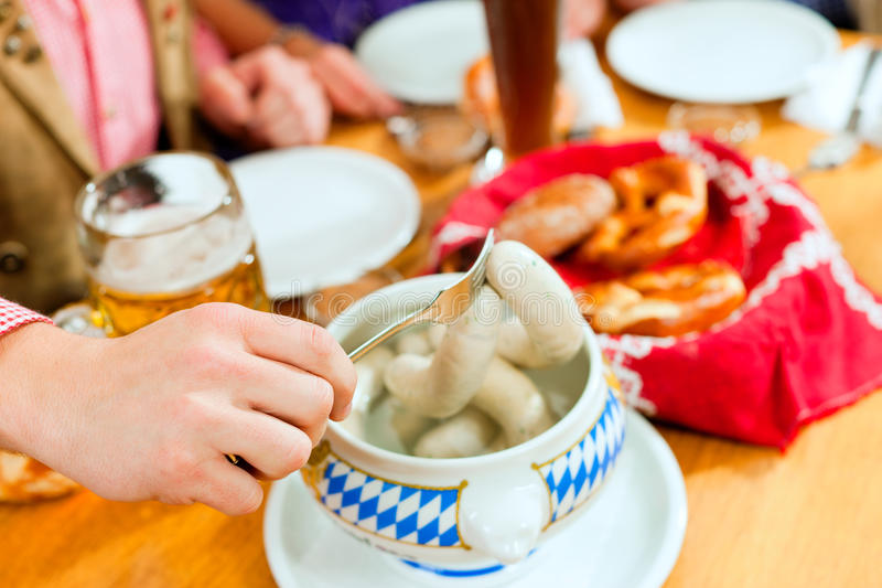 Breakfast with Bavarian white veal sausage royalty free stock images