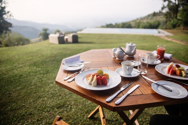 Breakfast with a beautiful view to the valley stock photo