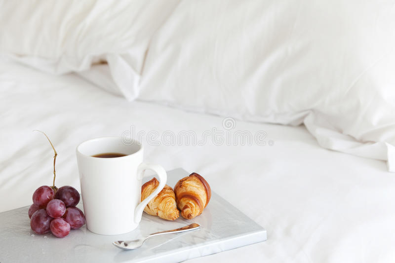Breakfast in bed. Tray with breakfast on a bed
