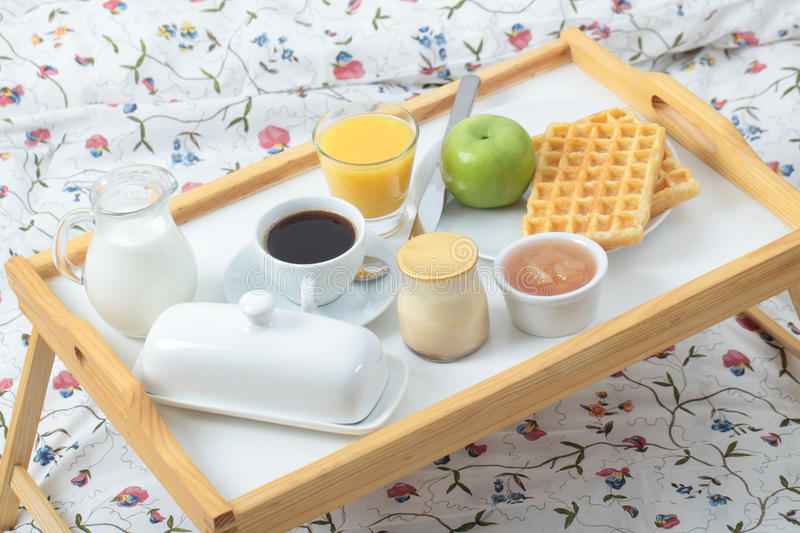 Breakfast on a bed stock images