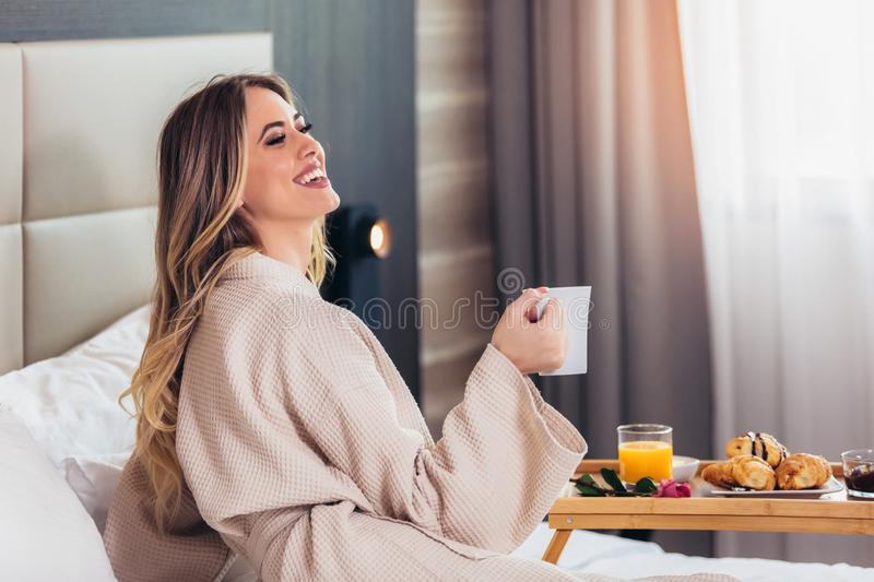 Breakfast in bed, cozy hotel room. royalty free stock photos