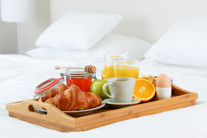 Breakfast in bed in hotel room. royalty free stock image