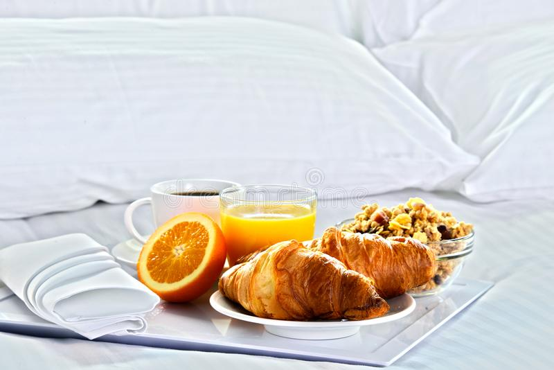 Breakfast in bed in hotel room. royalty free stock photos