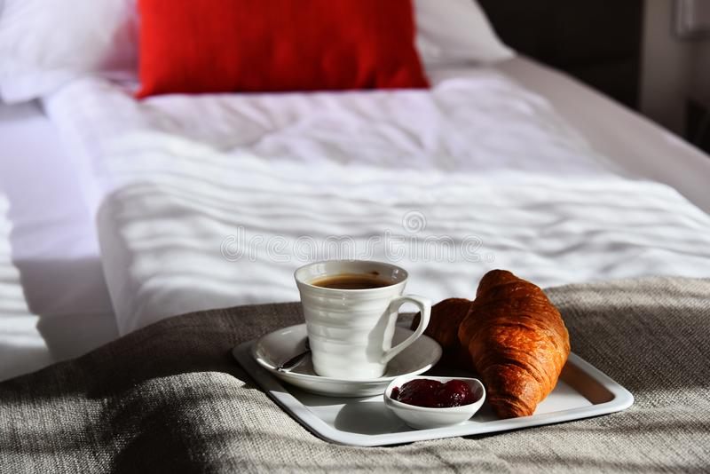 Breakfast in bed in hotel room royalty free stock images
