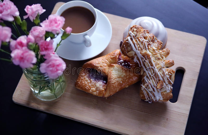 Breakfast in Bed. A rustic breakfast display with fresh coffee and delicious pastries stock images