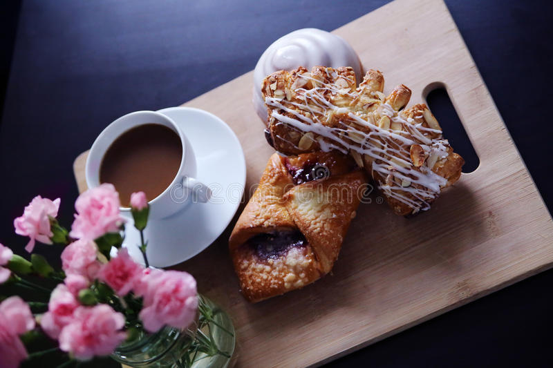 Breakfast in Bed. A rustic breakfast display with fresh coffee and delicious pastries royalty free stock photos