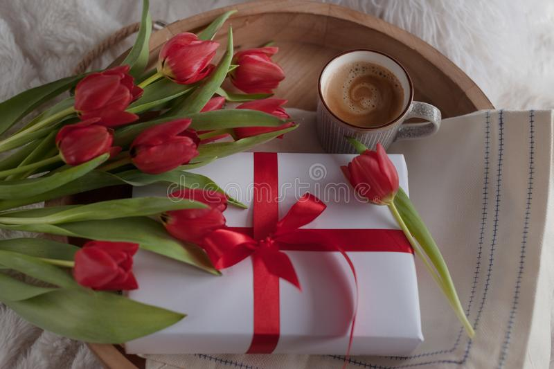 Breakfast in bed on a tray of flowers. Morning surprise in the concept of the holiday of the mother`s day and March 8, women`s d royalty free stock photo