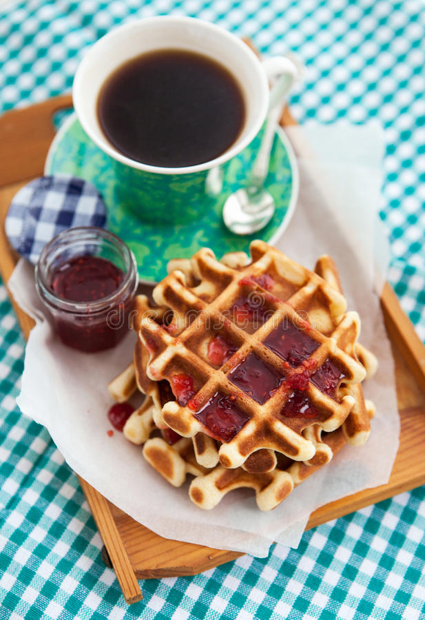Breakfast with belgian waffles with jam and coffee stock image