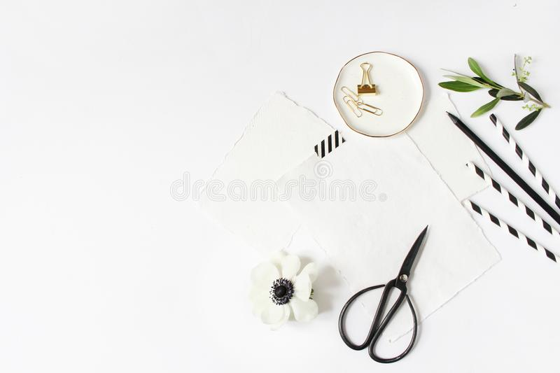Breakfast or birthday party desktop scene. Composition with empty milk glass jar, black and white drinking paper straws stock image