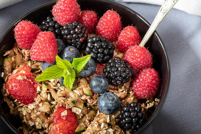 Breakfast bowl with cereals and berries stock photos