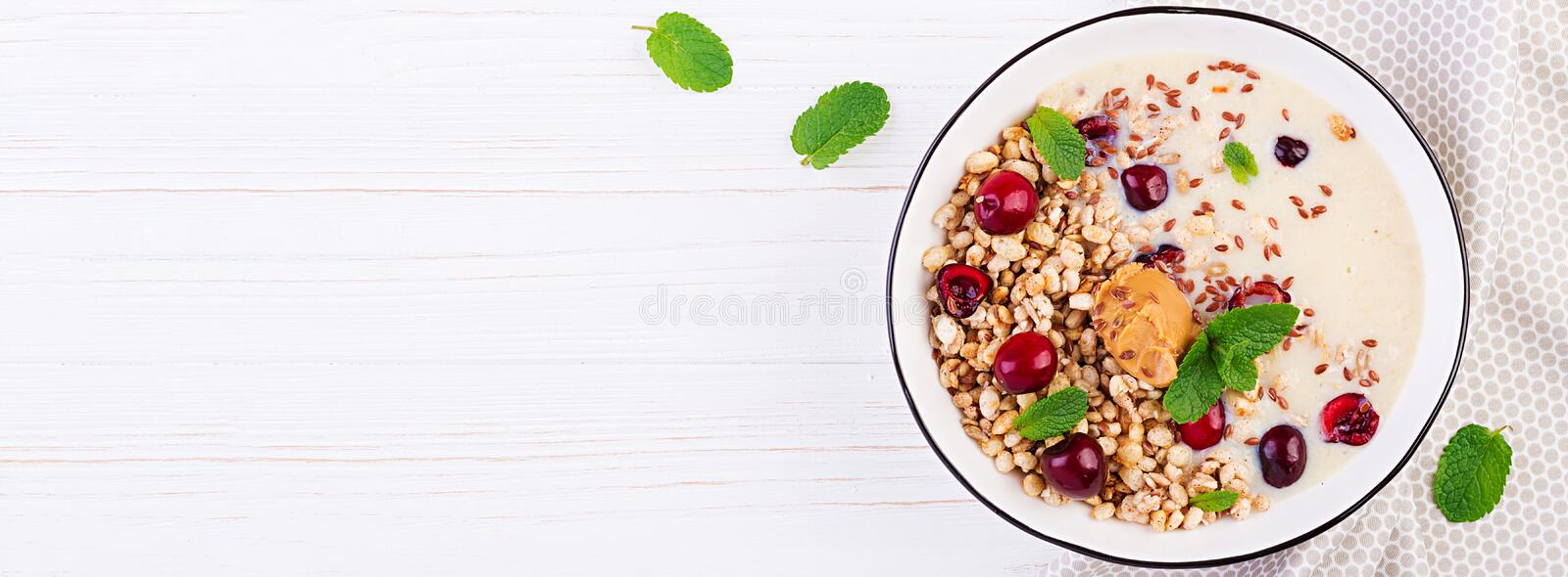 Breakfast. Bowl of homemade granola with banana mashed and fresh berries. Table setting. Healthy food. Banner. Top view stock photography