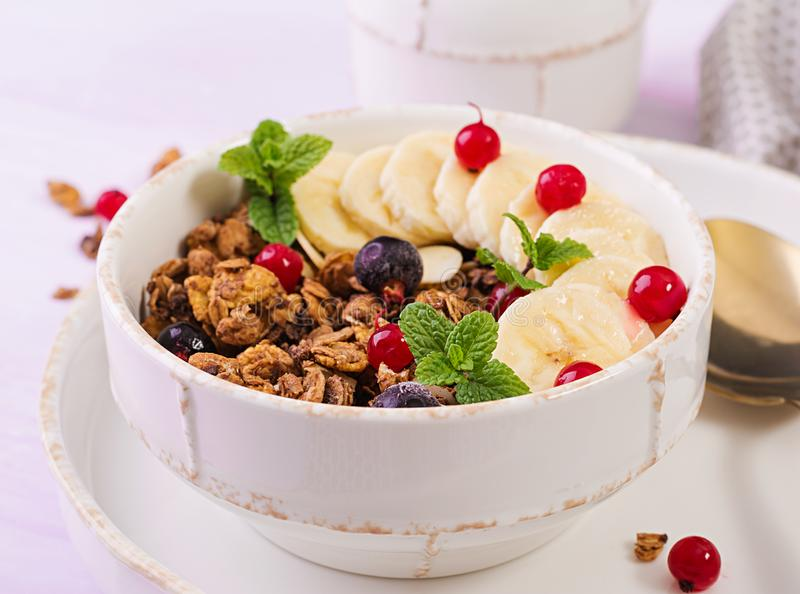 Breakfast. Bowl of homemade granola with yogurt and fresh berries. Table setting. Healthy food stock image