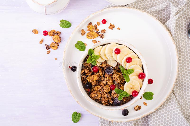 Breakfast. Bowl of homemade granola with yogurt and fresh berries. Table setting. Healthy food. Top view stock photography
