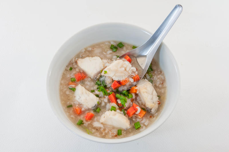 Breakfast with bowl of wild and brown rice soup with fish. For heathly stock photos