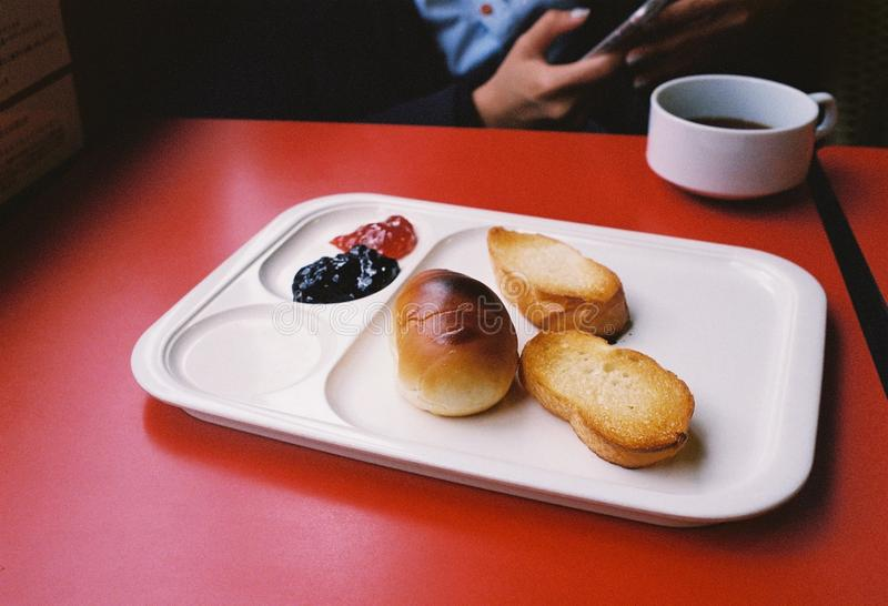 Breakfast bread with jam and coffee stock photos