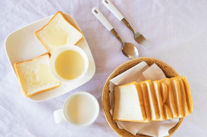 Breakfast, bread and milk on the table. stock photos