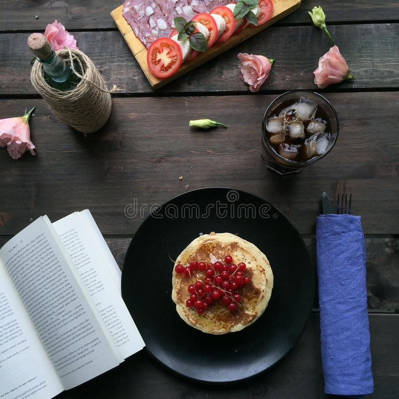 Breakfast. With book and coffee royalty free stock image