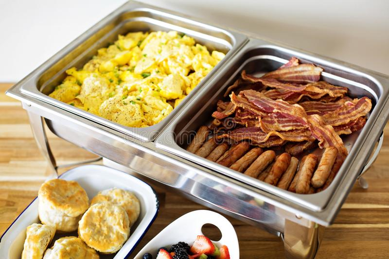 Breakfast buffet with scrambled eggs and bacon. Breakfast buffet with scrambled eggs, sausage and bacon stock photos