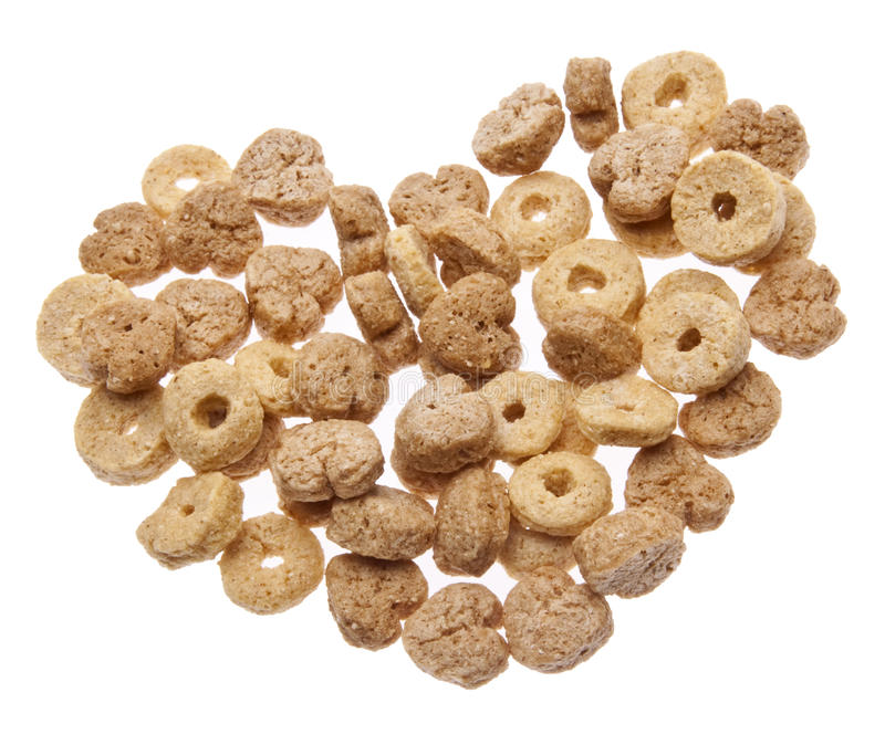 Breakfast Cereal with Heart Shapes. In a Heart Shape Isolated on White with a Clipping Path royalty free stock images