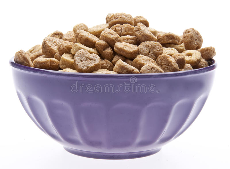 Breakfast Cereal with Heart Shapes. In a Purple Bowl Isolated on White with a Clipping Path stock photography