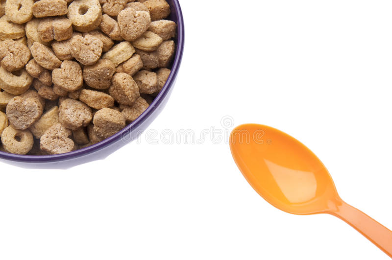 Breakfast Cereal with Heart Shapes. Breakfast Cereal Border Image with Spoon with Heart Shapes Isolated on White with a Clipping Path royalty free stock image
