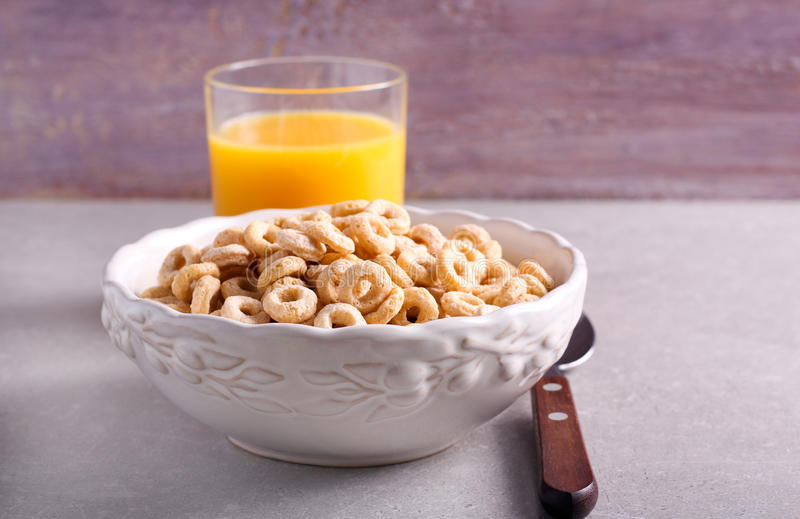 Breakfast cereal hoops in a bowl stock photography