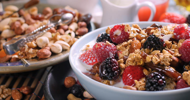 Breakfast of cereals with berries and dry fruits. Breakfast of cereals with berries, dry fruits and milk stock images