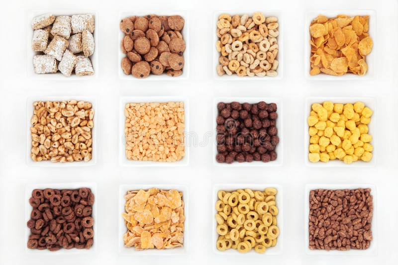 Breakfast Cereals. Sweet breakfast cereal selection in porcelain square dishes over white background royalty free stock photos