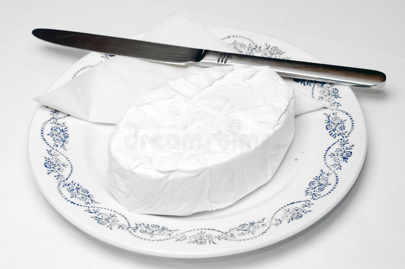 Breakfast with cheese. Breakfast, daily morning food. Plate with brie cheese isolated, photographed over white royalty free stock images
