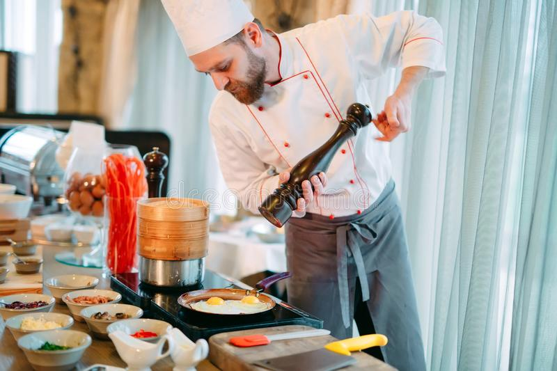 Breakfast. The chef prepares eggs for Breakfast. Breakfast. The chef prepares eggs for Breakfast royalty free stock photos