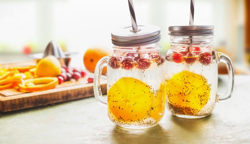 Breakfast Chia seeds water in Mason jars on table with orange slices and cranberries. Natural detox energy drink.  Proper. Nutrition, healthy supplements stock photos