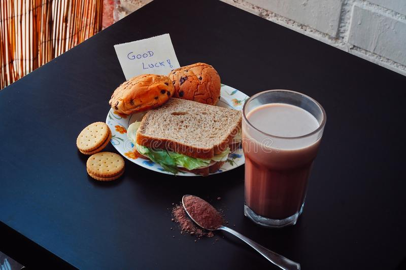 Breakfast of a child. Breakfast of a child next to a role in which he puts: Good luck royalty free stock photos