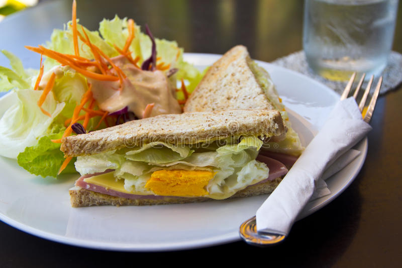 Breakfast,Club sandwich and salad. Breakfast with tasty Club sandwich and salad stock photography