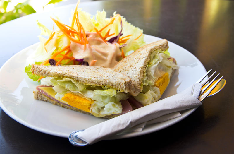 Breakfast,Club sandwich and salad. Breakfast with tasty Club sandwich and salad royalty free stock images