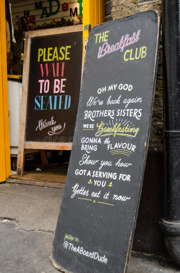 Breakfast Club sign, Hoxton. LONDON, UNITED KINGDOM - AUGUST 30, 2014: Blackboard signs outside the fashionable cafe Breakfast Club in the trendy district of stock image