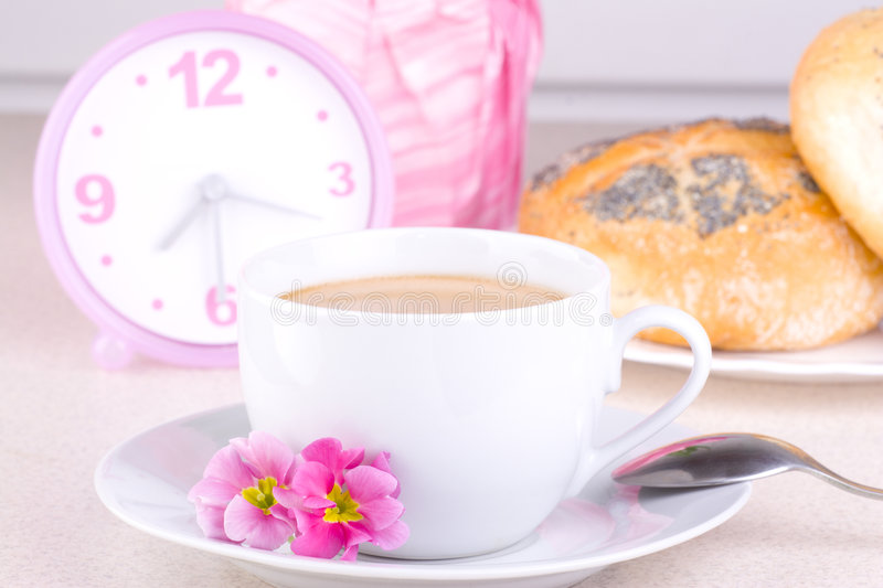 Breakfast Coffee. A breakfast with coffee and a clock in the background stock photos
