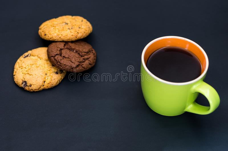 Breakfast with coffee and biscuits. Kind of composition at an angle. Composition on a dark background stock photography