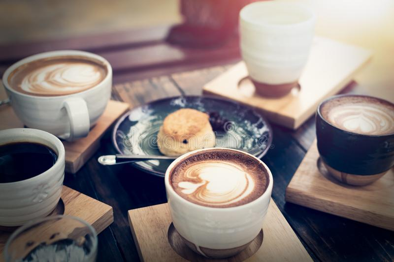 Breakfast with coffee and bread on wooden table. Under sunlight, Vintage color tone, Meeting concept stock images