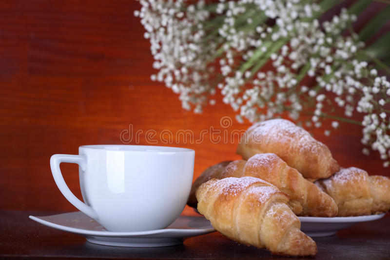 Breakfast. With coffee and croissants royalty free stock photo