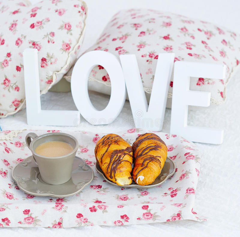 Breakfast coffee, croissants and wooden love letters royalty free stock images