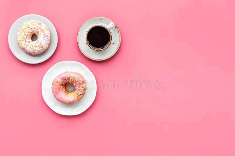 Breakfast with coffee, donuts and flowers on pink background top view mockup. Breakfast with coffee, donuts and flowers on pink table background top view mockup stock photos
