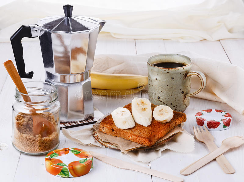 Breakfast with coffee and toast over white wooden background royalty free stock image
